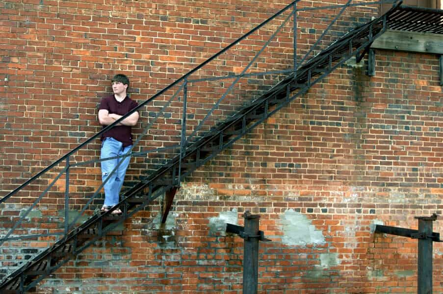 Teenager Leaning Against a Wall